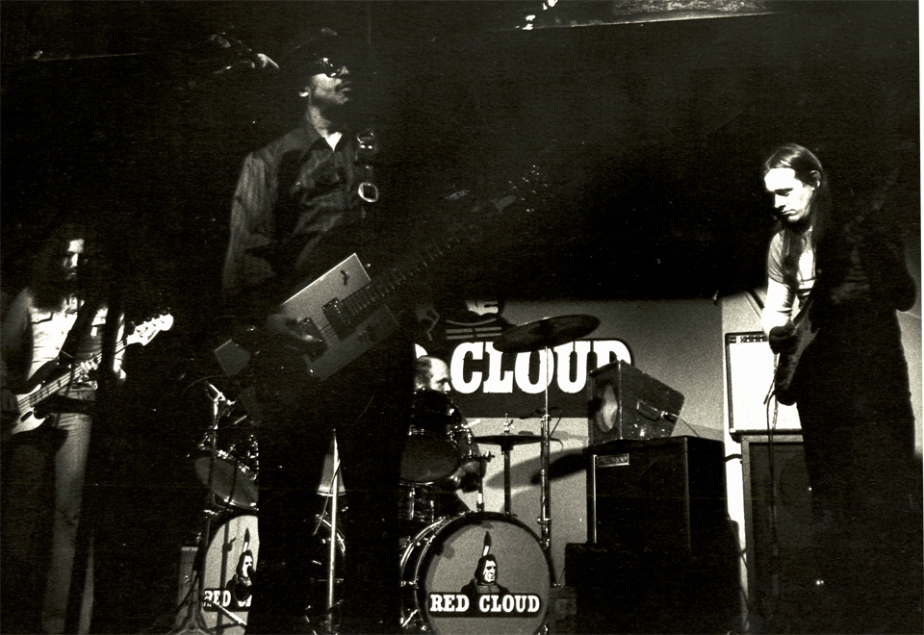 image of Russell Moran on guitar and Bo Diddley with box guitar on stage 1976